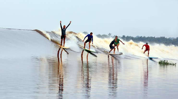 Berwisata Sambil Menguji Adrenalin Ombak di Objek Wisata Bono Sungai Kampar